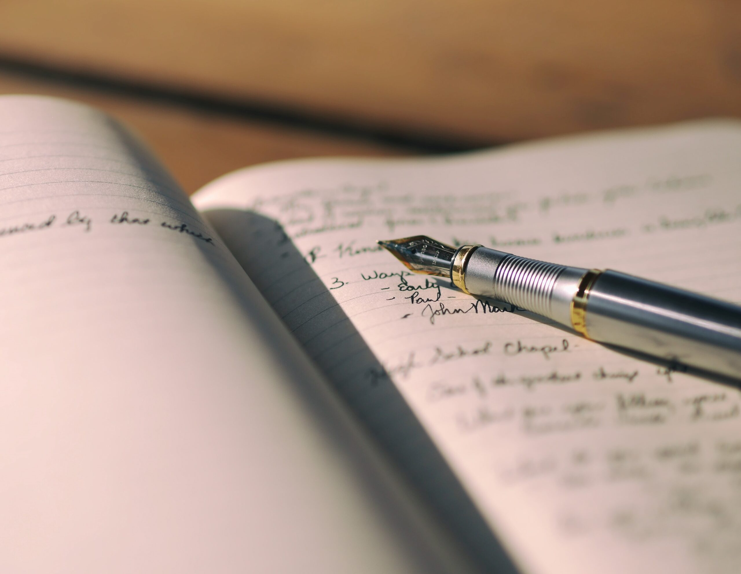 a pen is sitting on top of an open journal
